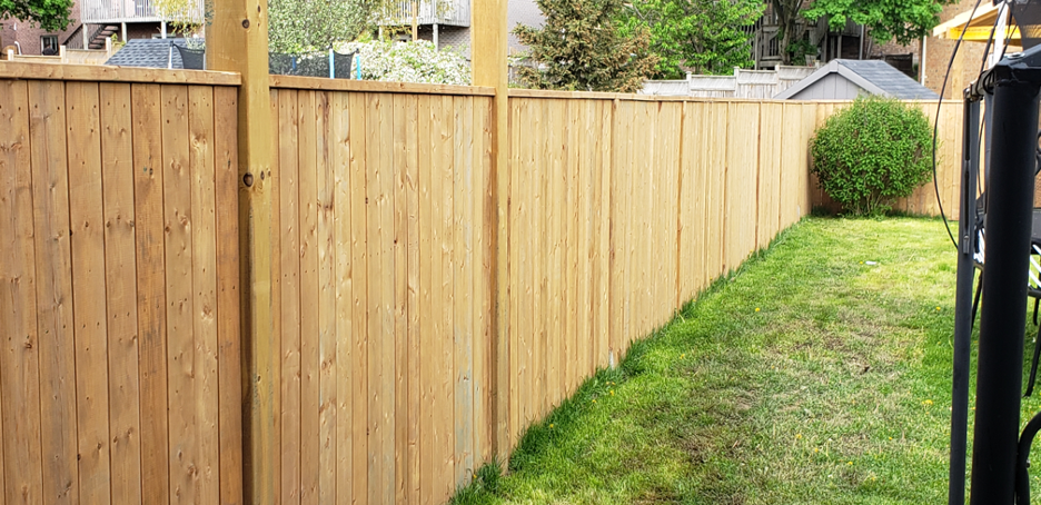 New wooden fence in a backyard in Glenview, Illinois