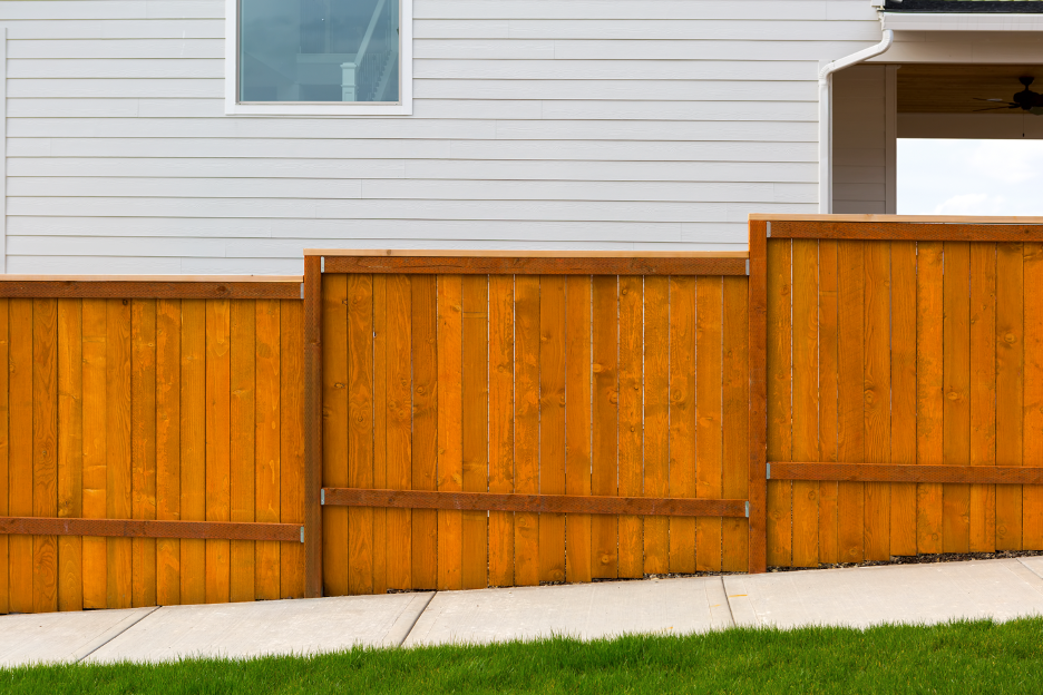 Residential backyard wood fence at a house in Highwood, Illinois
