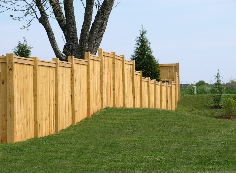 Wood fence installation at a house in Wauconda, Illinois